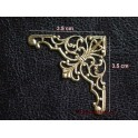 Motif métal doré arabesque